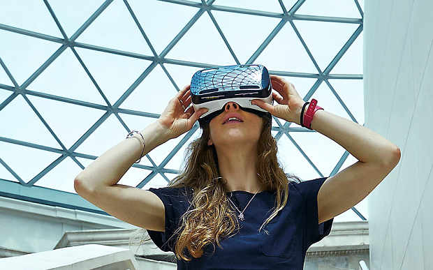 Model wears a Samsung Gear VR headset in the Britis h Museumís Great Court. © The Trustees of the British Museum